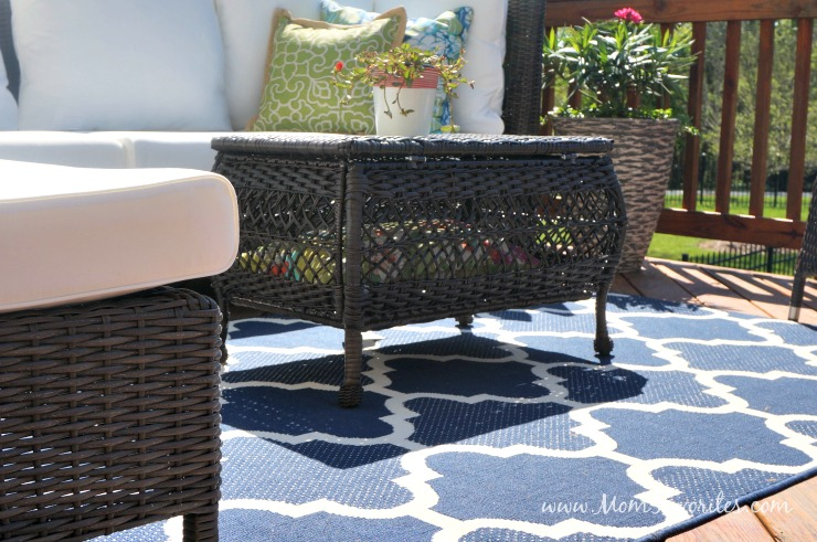 Turn a blah deck into a lush and comfy outdoor living room! Get the deets on this budget-friendly outdoor transformation!