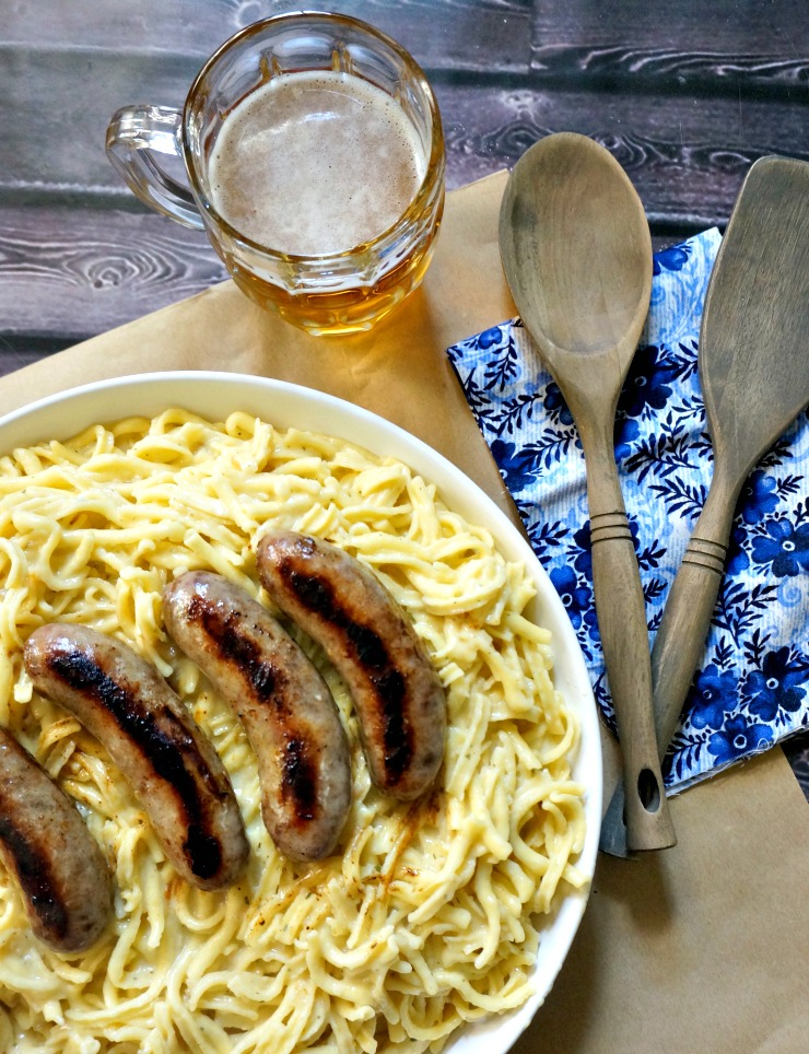 Favorite German Fare! Käse Spaetzle with Beer-Braised Brats bring German comfort food to your plate with authentic German ingredients from World Market.