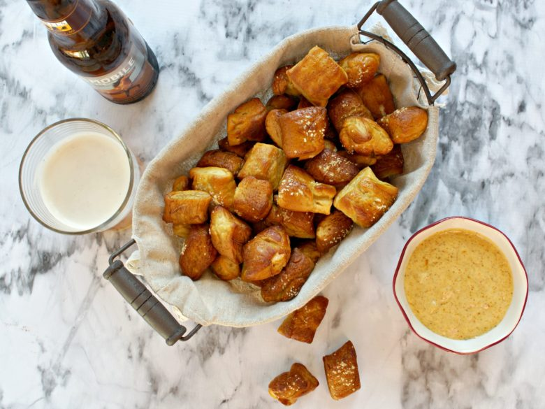 Recreate the beer garden experience at home! Celebrate spring this weekend with friends, craft brews, and these homemade pretzel nuggets with a cajun mustard dip. Your backyard will be the place to party with this recipe!