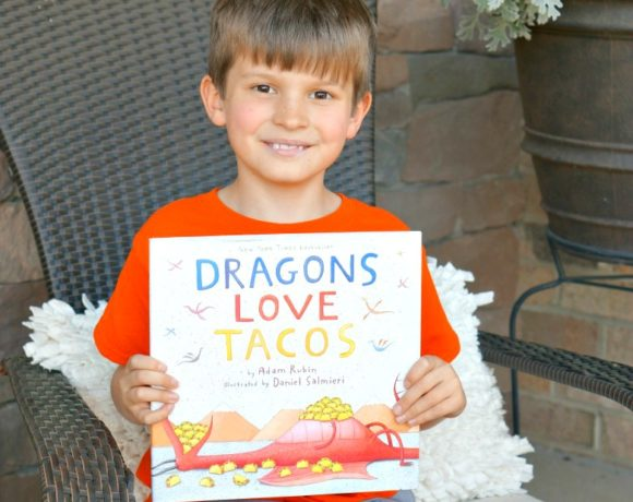 "For our newest installation of Kitchen Stories, we're reading ""Dragons Love Tacos"" by Adam Rubin. Just like the dragons in the book, however, we're avoiding everything spicy. Be sure to save this Classic Slow Cooker Beef Tacos recipe that even the pickiest kids will love!"