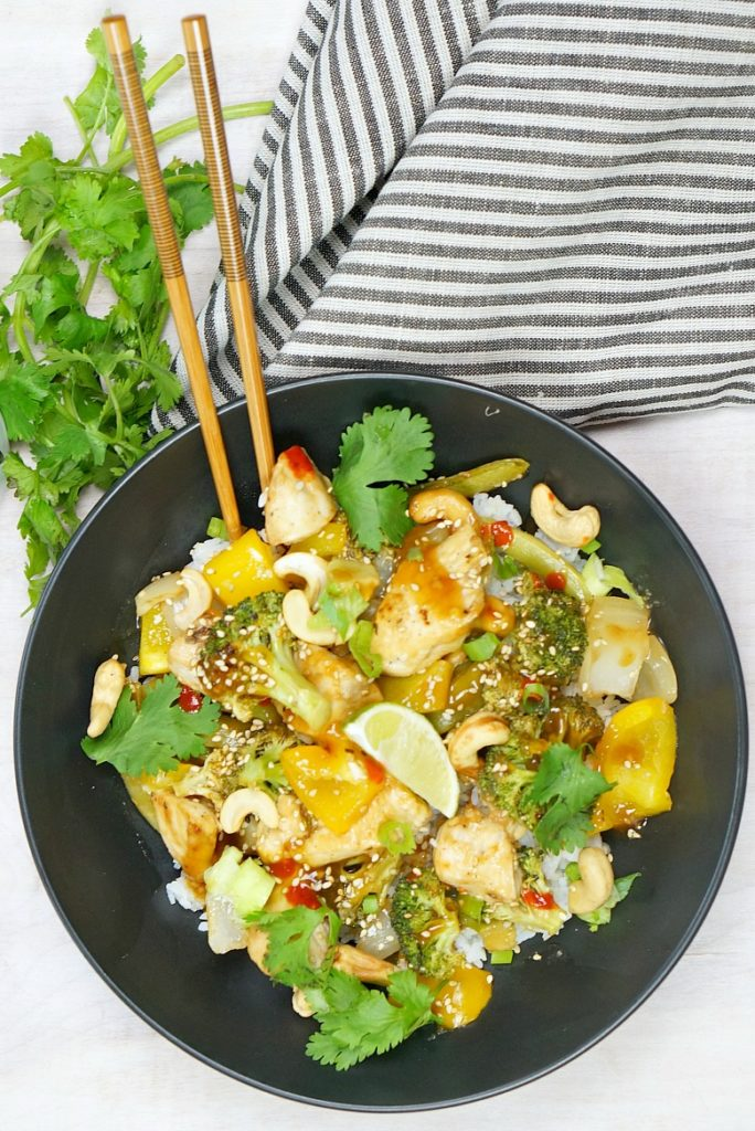 Save the expense and make this classic Asian takeaway favorite at home!  Our easy sheet pan cashew chicken is delicious, colorful and full of your favorite veggies.  See for yourself in our how-to recipe video!