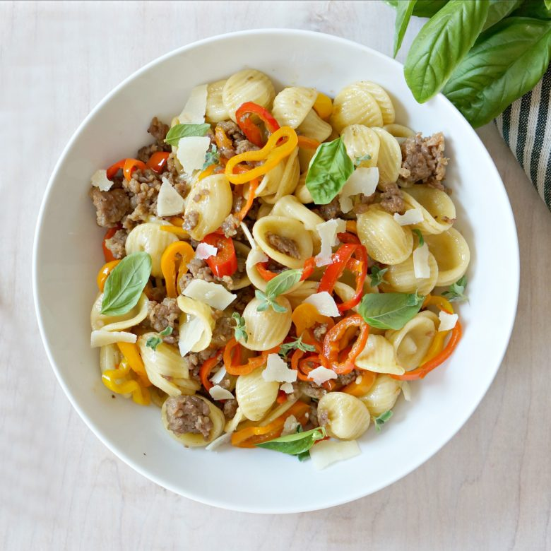 The beautiful colors aren't the only thing to rave about in this Summer Orecchiette with Sausage and Peppers.  It's delicious too!  And did we mention it comes together in less than 20 minutes?  Winning!