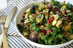 Charred Brussels Sprout and Kale Salad with pomegranate arils is the perfect red and green side dish for your holiday table!  Serve it alongside your turkey dinner or with whole fish for a delicious and festive meal.