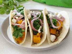 Holiday entertaining just got healthier!  With these Hearty Veggie Sweet Potato Tacos, all will be able to feast!  Filled with MorningStar Farms® Grillers® Crumbles™, roasted sweet potatoes and sautéed kale, the table will be merry and bright!