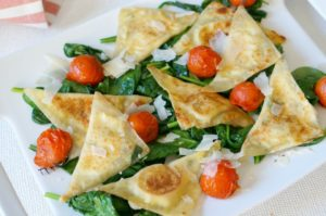 This Toasted Wonton Ravioli recipe is a great date-night in recipe! Skip the labor of making pasta and use wonton wrappers instead.