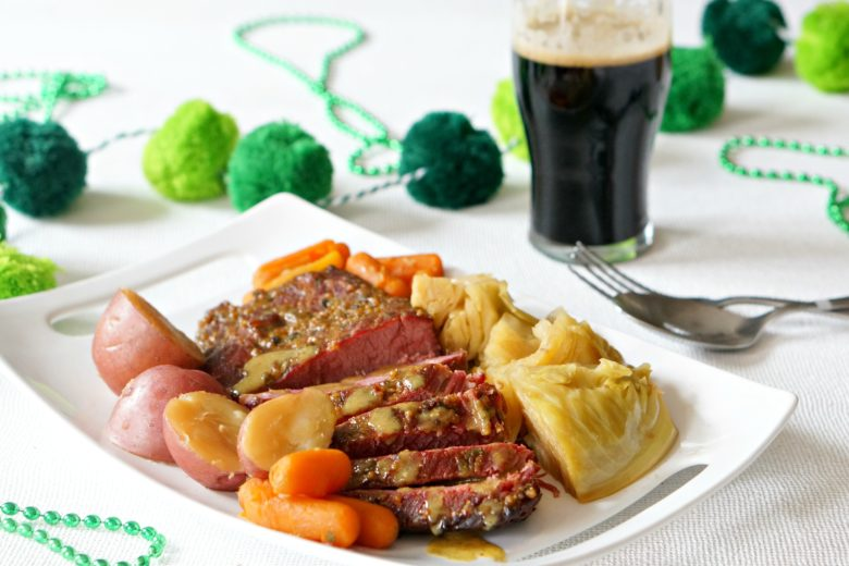 This Instant Pot Corned Beef with Honey Mustard Glaze will have you feeling pretty darn lucky this St. Patrick's Day!  Bursting with flavor and with instructions for cooking in a slow cooker, everyone will enjoy this dish, Irish or not.