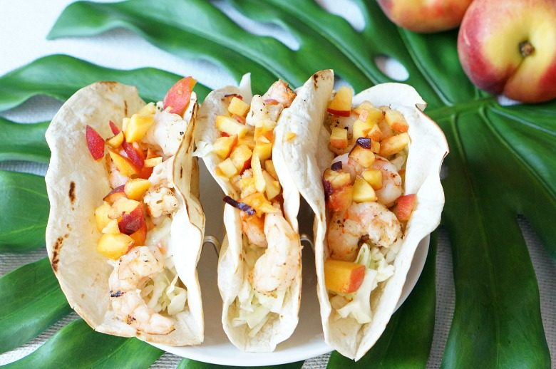 Fresh ingredients and summer fruit make these Grilled Shrimp and Peach Summer Tacos your favorite warm-weather supper.  Ready in 30 minutes or less!