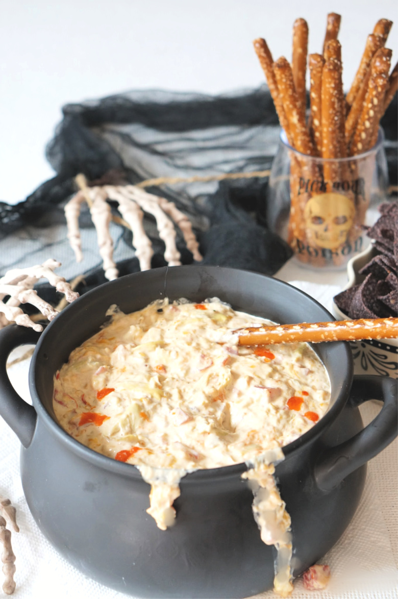 Double, double toil and trouble; Fire burn, and cauldron bubble... it's time to get our spooky on.  With Spicy Tomato Artichoke Dip served Halloween-style!