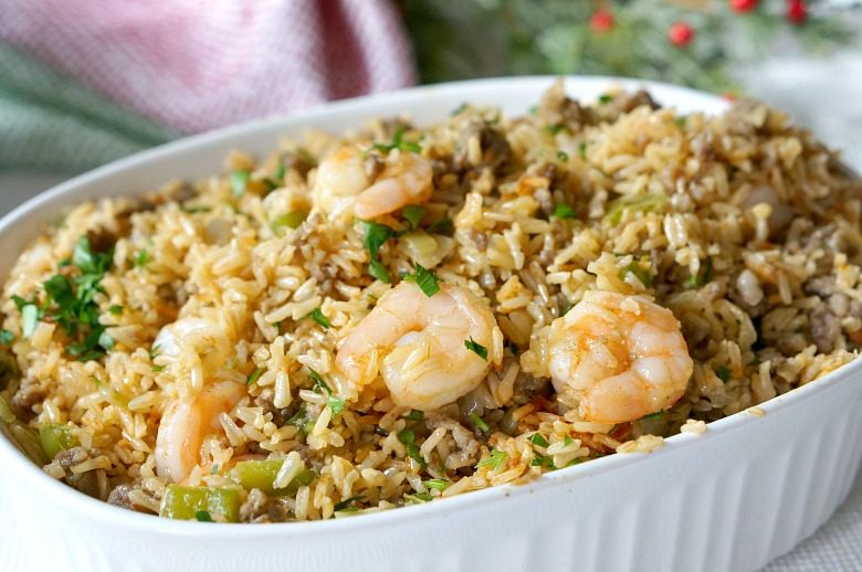Our Spicy Dirty Rice Dressing with Shrimp & Sausage will fast become a family tradition on the holiday table.  Brown rice, pork sausage, shrimp and the perfect amount of kick will make this dirty rice dressing a dish you'll want seconds of!