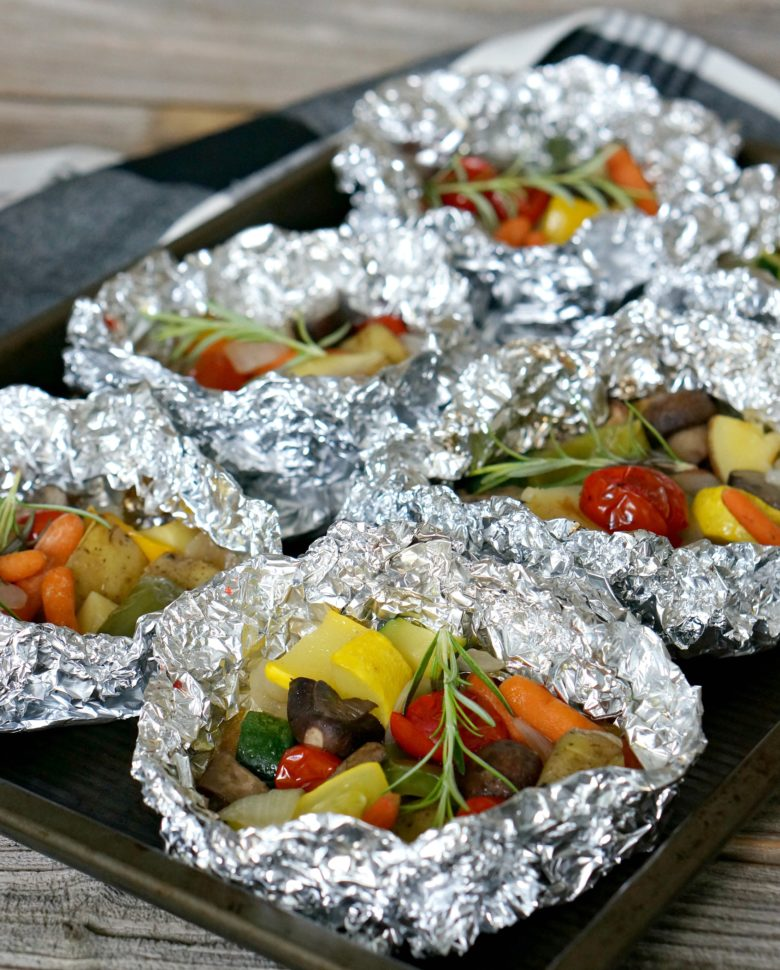 Easy Grilled Veggie Foil Packets are the answer to your lazy-days-of-summer suppers. With just a few ingredients, this will be your new summer side dish for week night dinners or cookouts!