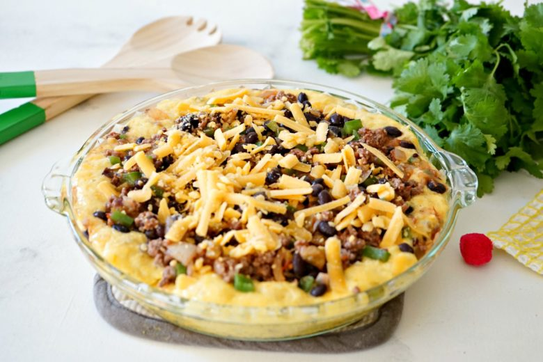 Taco Tamale Pie is the comfort food recipe you need to make for busy family weeknight dinners.  The combo of meat, beans, veggies and cornbread means it's a one dish meal, too.